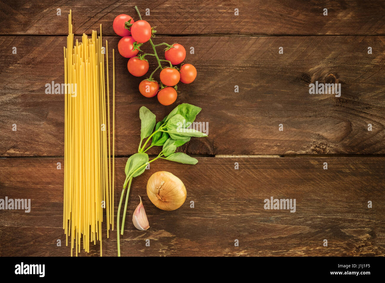 Basic pasta ingredients, spaghetti and vegetables - Stock Image
