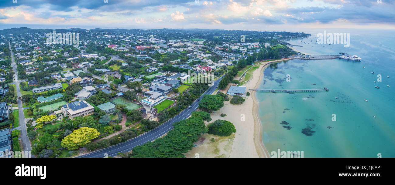 Aerial panoramic view of Sorrento Long Pier, moored passenger ferry and Point Nepean Road at dawn.  Mornington Peninsula, Stock Photo