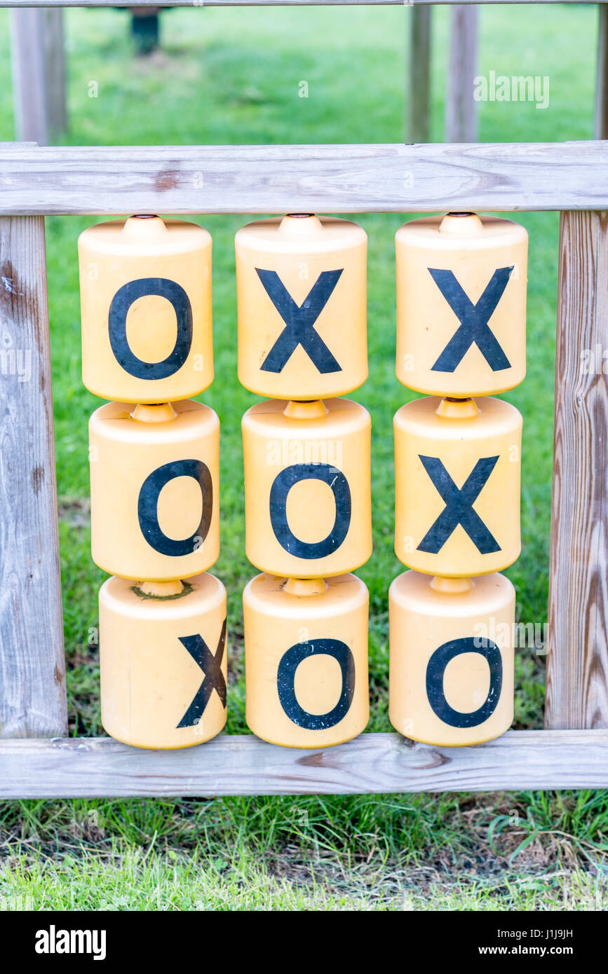 Day view of Tic Tac Toe game outside playground. - Stock Image