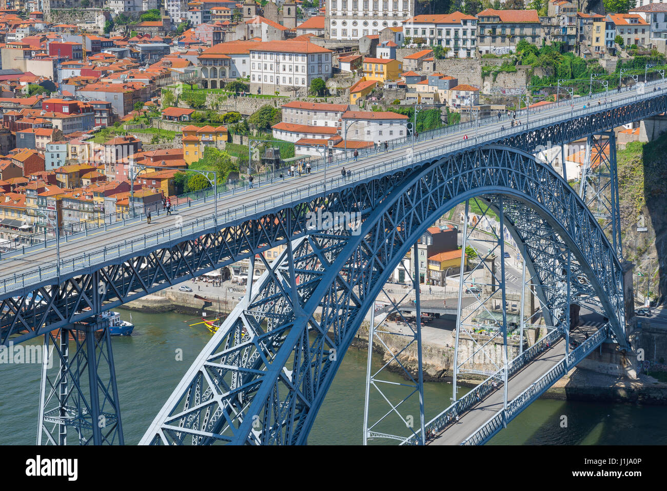 Porto Portugal bridge, people walk across the upper level of the Dom Luis bridge spanning the Douro River in the - Stock Image