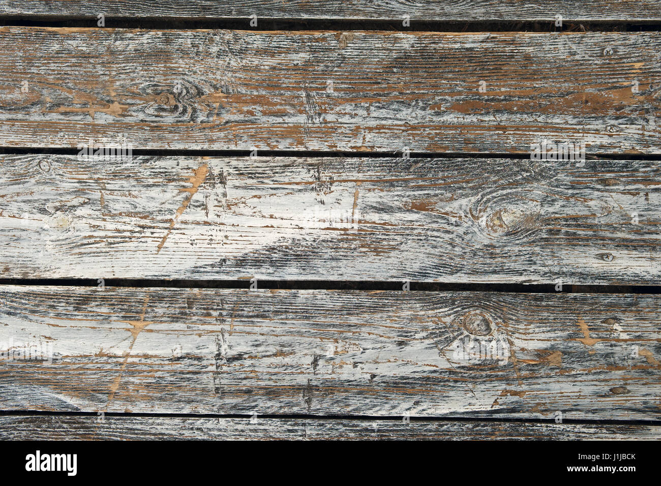Horizontal old cracked wooden plates with horizontal gaps, planks and chinks Stock Photo