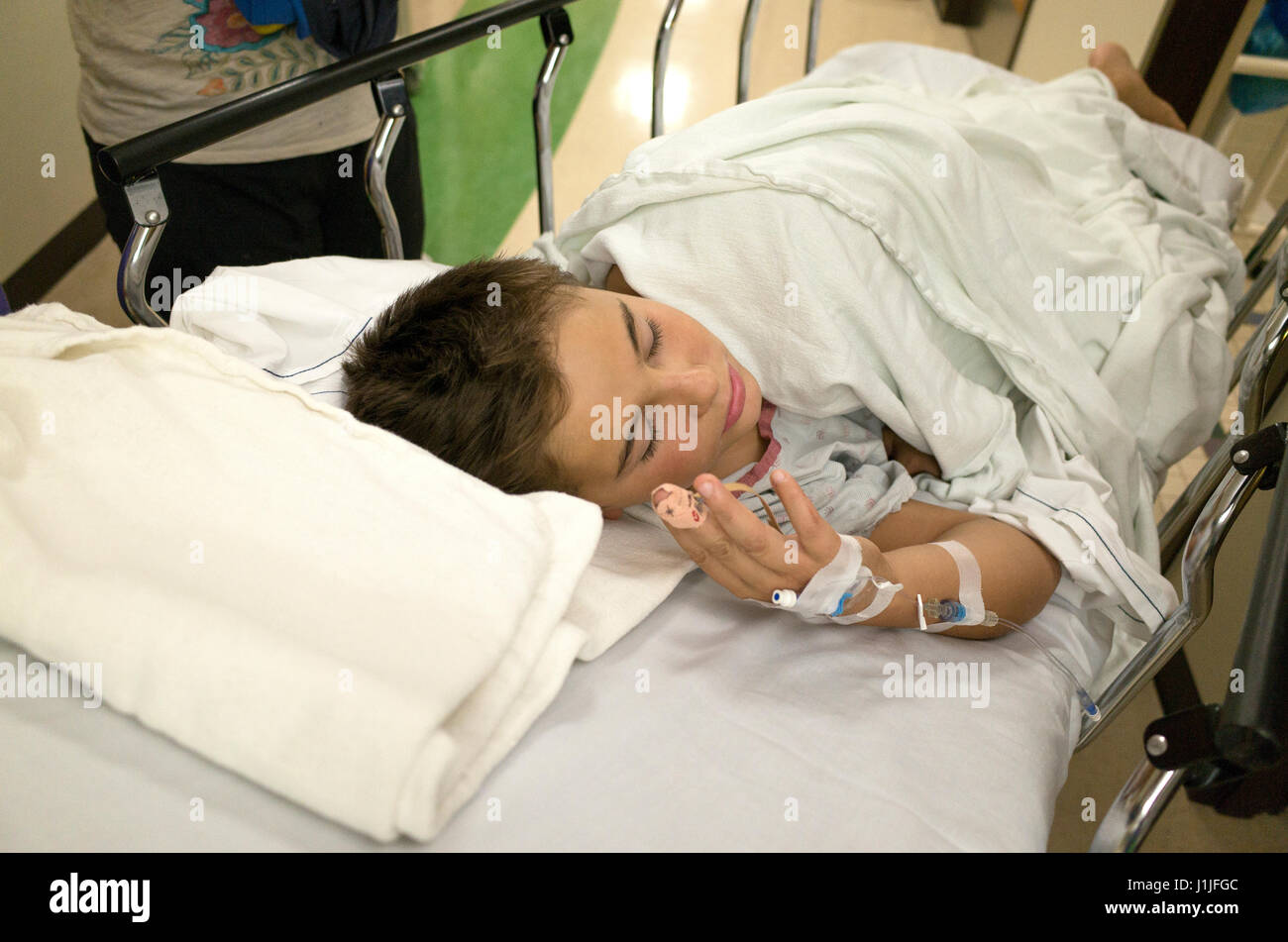Boy on hospital bed recovering from appendicitis surgery. St Paul Minnesota MN USA - Stock Image