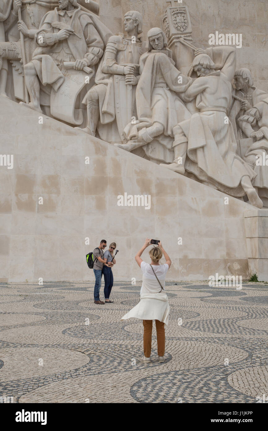 People taking photographs of the Monument to the Discoveries in Lisbon, Portugal. - Stock Image