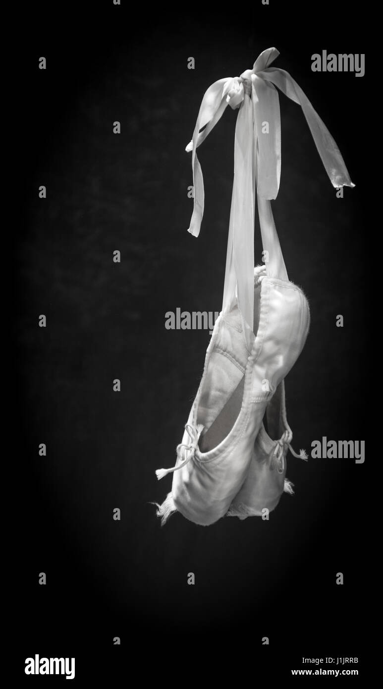 Frayed ballet pointe shoes underwater - Stock Image