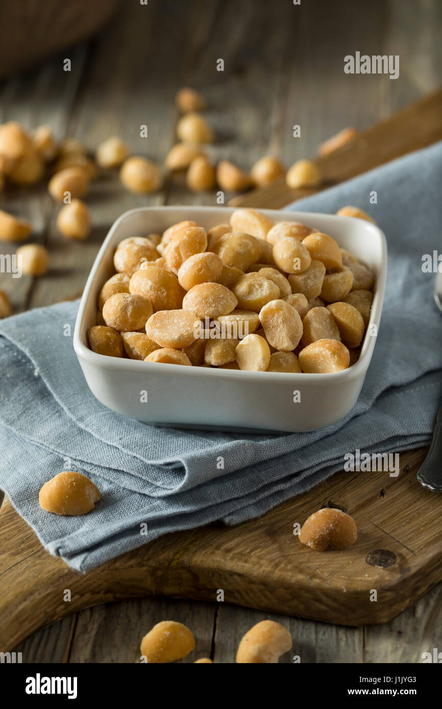 Roasted Macadamia Nuts with Sea Salt and Spices - Stock Image