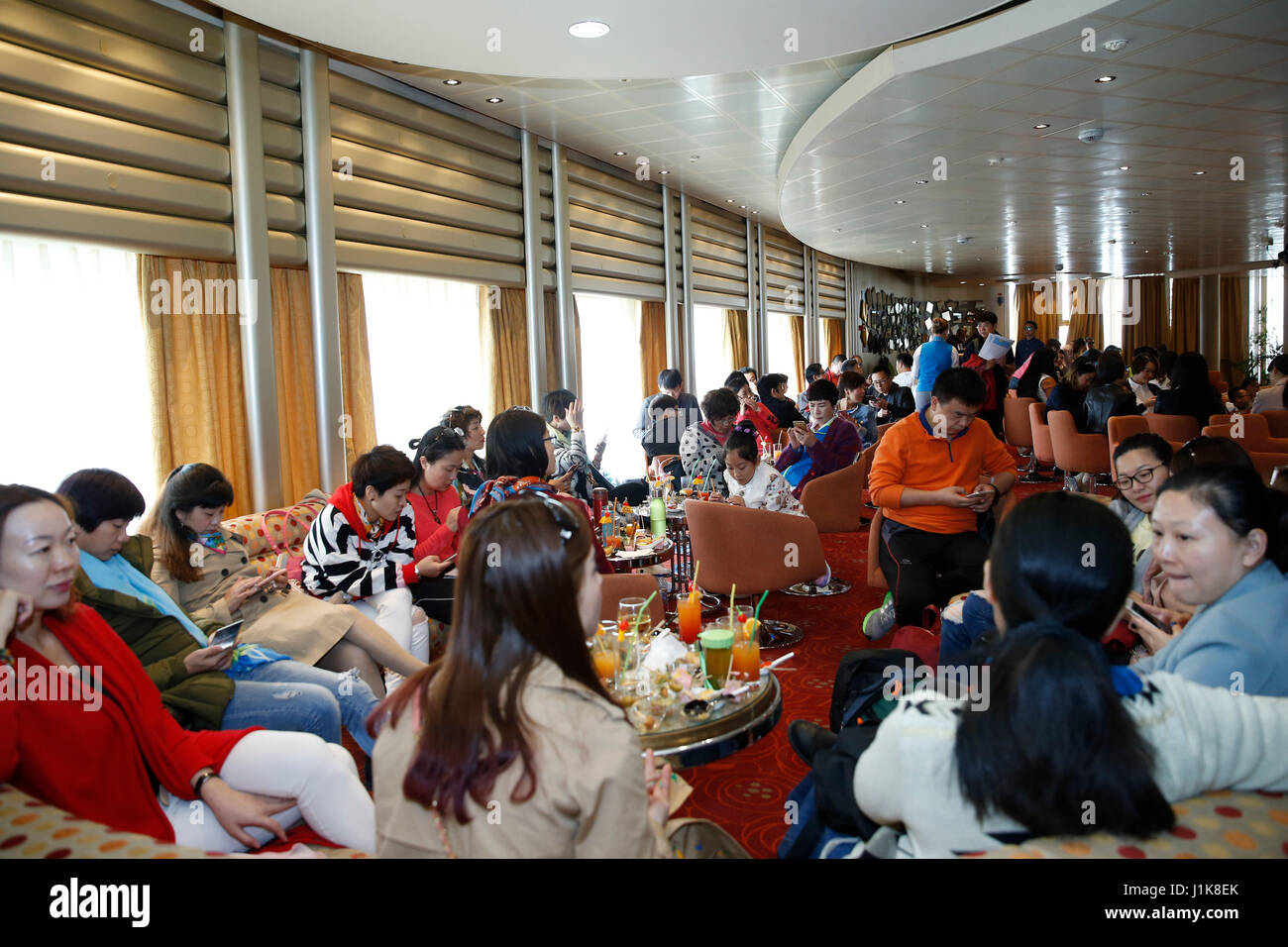 Athens, Greece's largest port. 21st Apr, 2017. Chinese Tourists rest at a Celestyal Cruises ship in Piraeus, Greece's Stock Photo