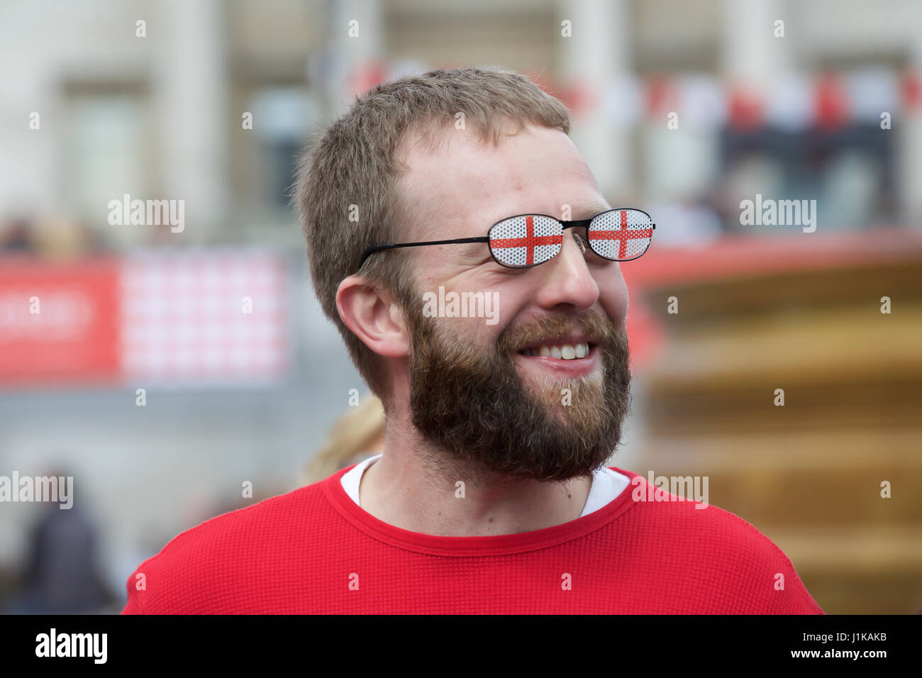 Trafalgar Square,UK,22nd April 2017,A man wears sunglasses with the St Georges cross on them at The Annual Feast - Stock Image