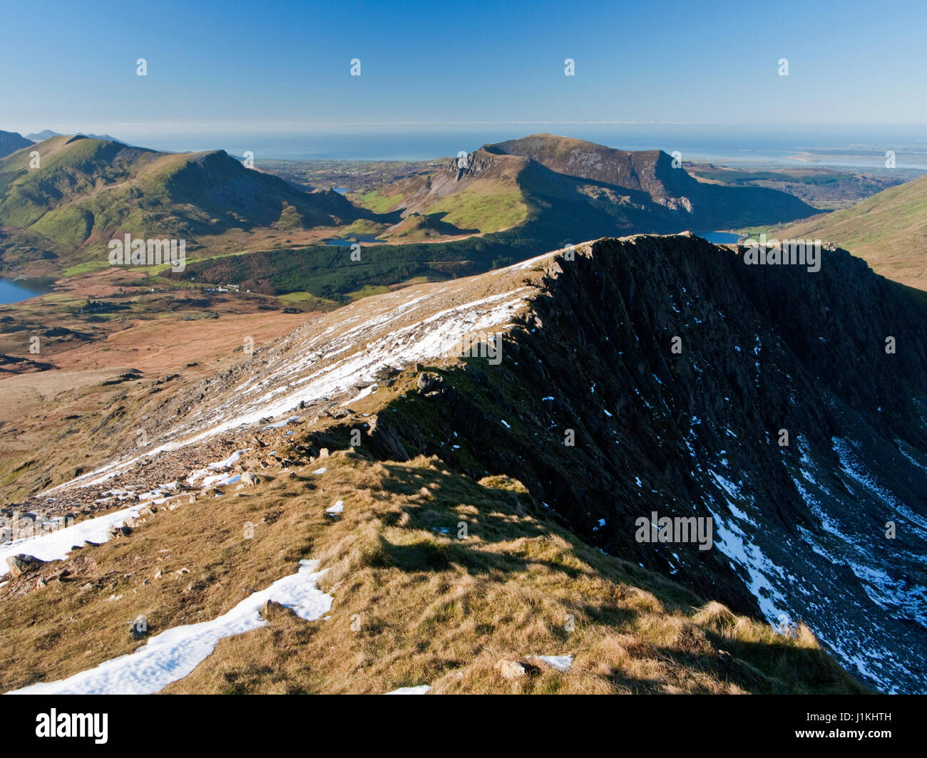 On Snowdon's Rhyd-Ddu path with a view across the cliffs of Llechog to Mynydd Mawr and the hills of the Nantlle Stock Photo