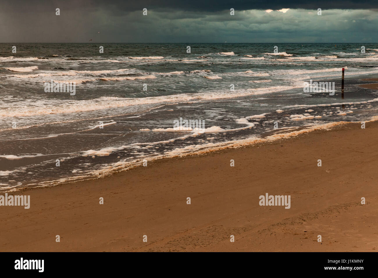 Dark sky above the sea on the island of Texel - Stock Image