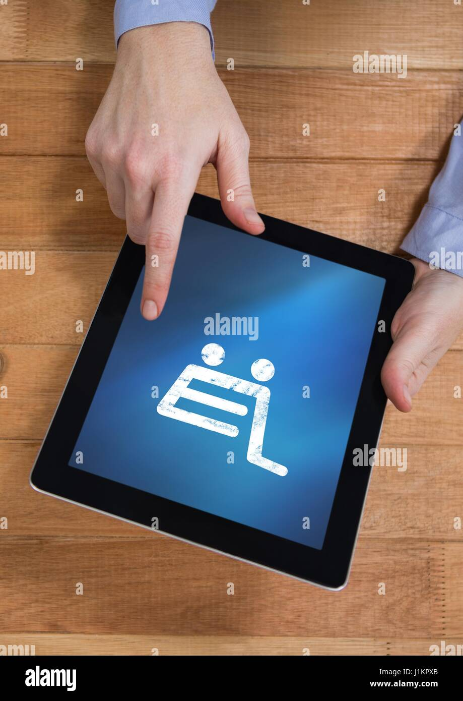 Digital composite of Person using Tablet with Shopping trolley icon - Stock Image