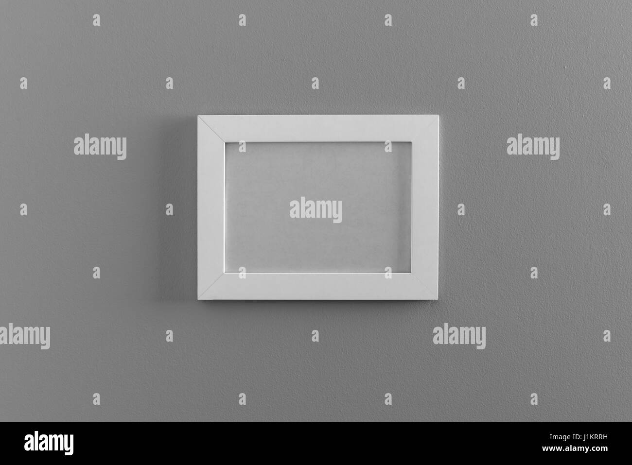 empty photo frame on wall - Stock Image