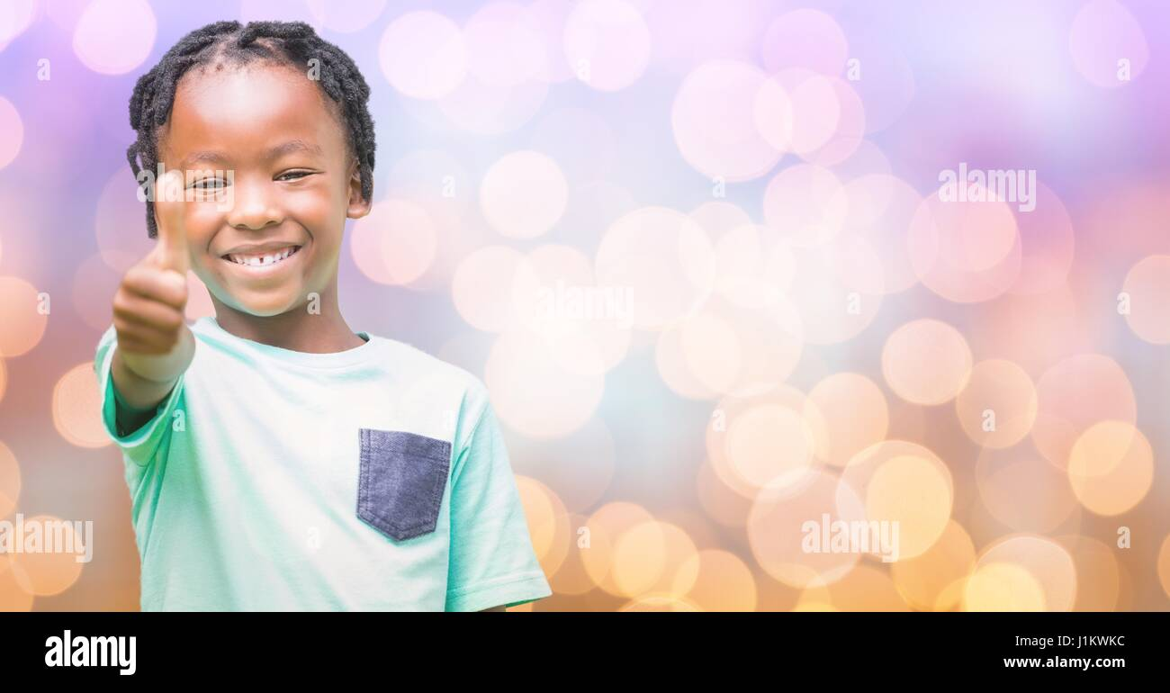 Digital composite of Happy girl showing thumbs up over bokeh Stock Photo