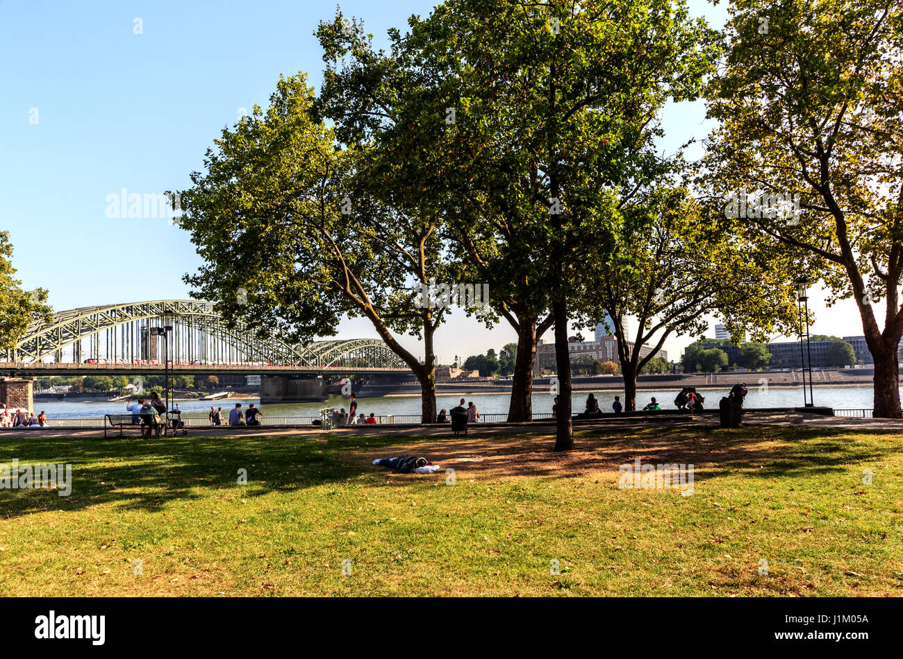 Landscape on the Rhine promenade in front of the Deutzer Bridge in Cologne, Germany Stock Photo