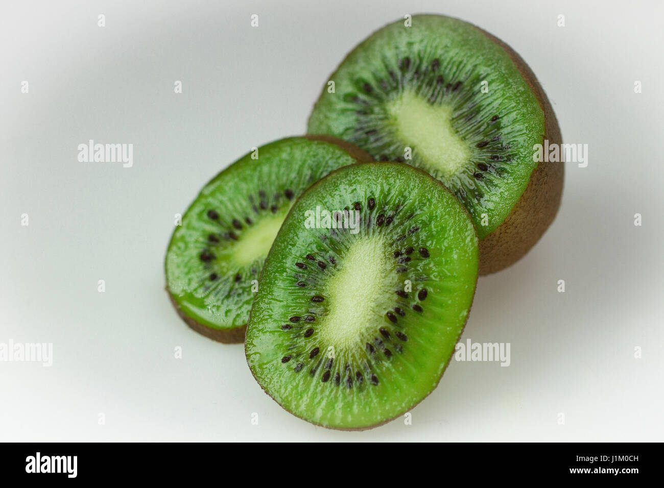 kiwi fruit, sliced and presented in the studio showing detail due to macro usage - Stock Image