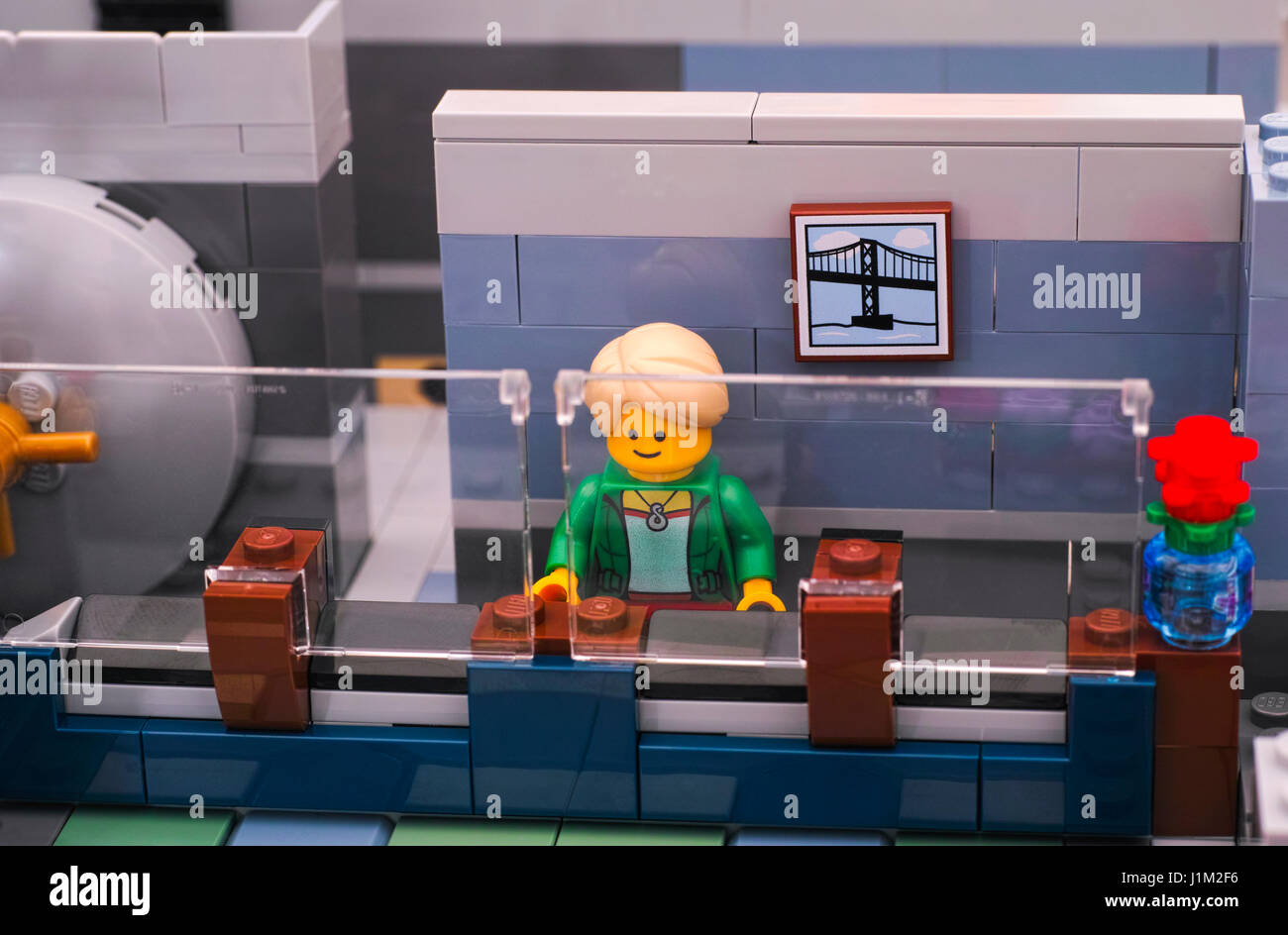 Tambov, Russian Federation - January 08, 2017 Lego bank manager on his working place with security glass in Brick - Stock Image