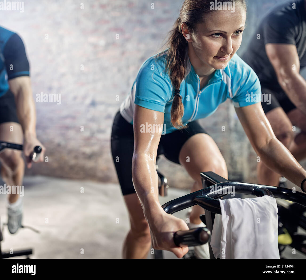 Woman on cardio exercising on bike, training, sport and healthy lifestyle - Stock Image