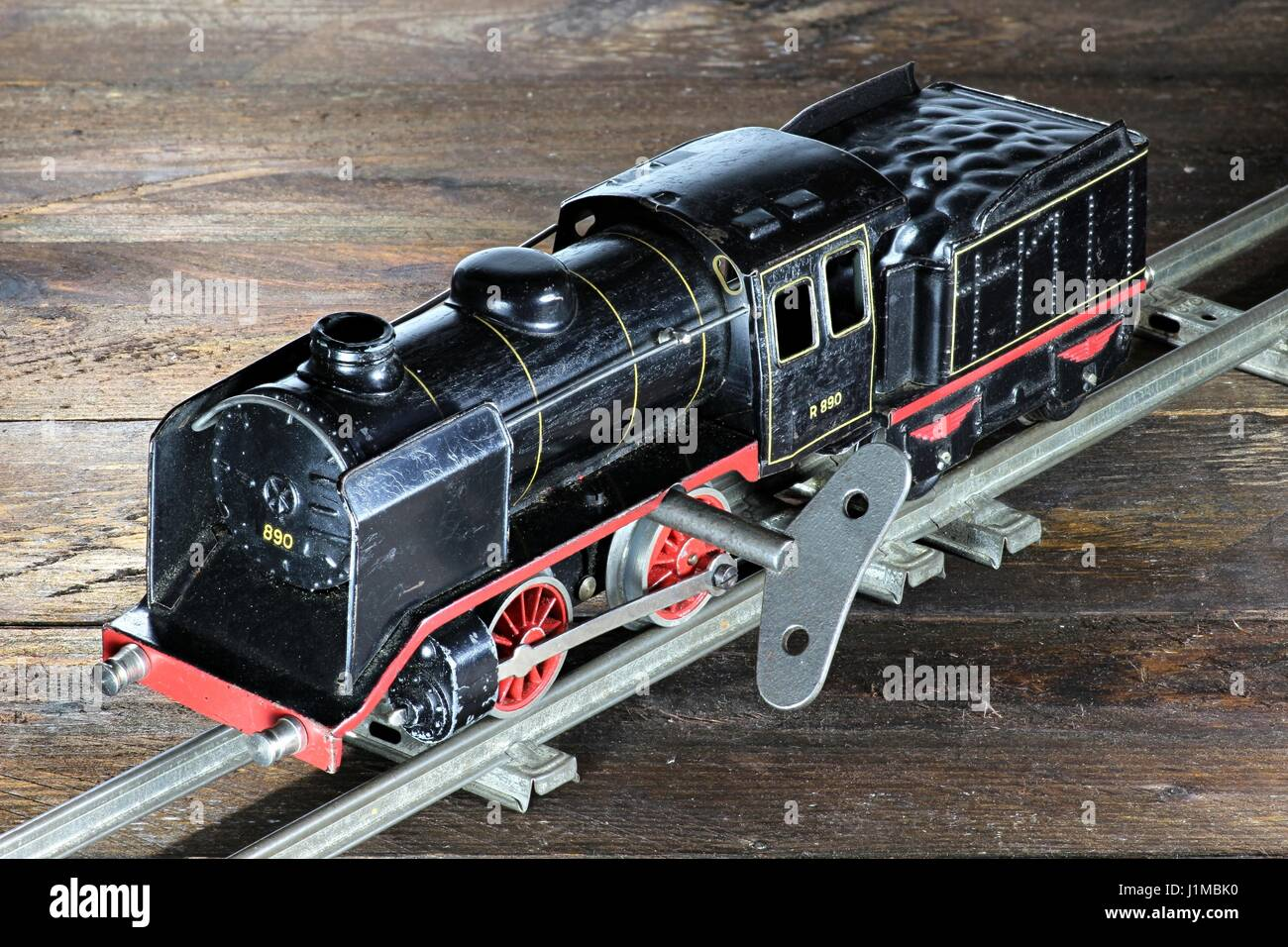 old model railway on wooden background Stock Photo