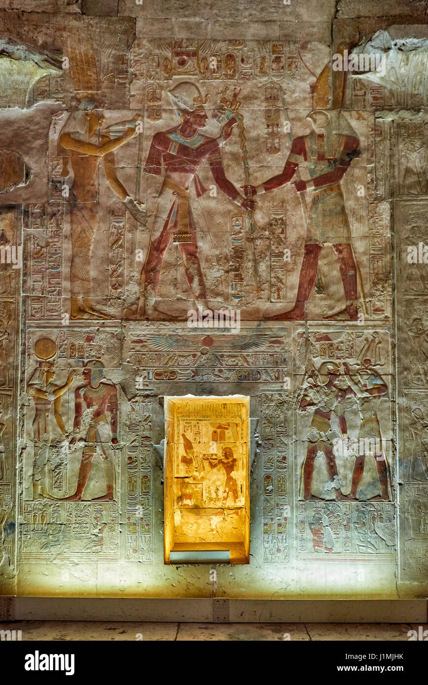 colorful stone carved reliefs in sanctuaries behind second Hypostyle Hall inside Temple of Seti I , Abydos, Egypt, - Stock Image