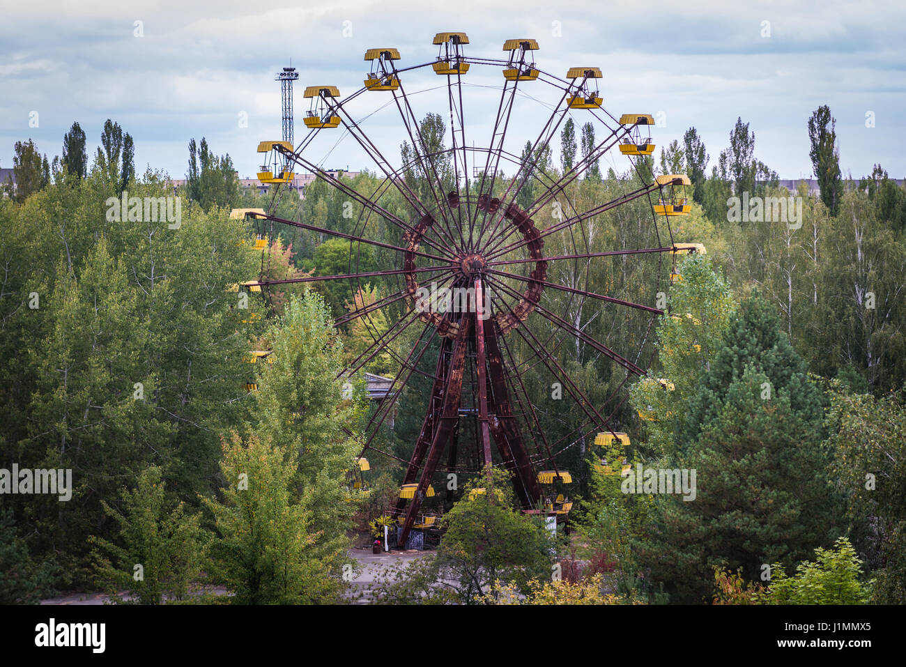 Ferris wheel in amusement park in Pripyat ghost city of Chernobyl Nuclear Power Plant Zone of Alienation around Stock Photo