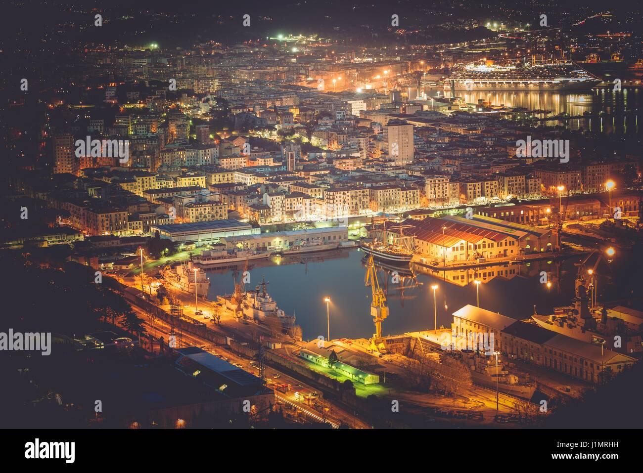La Spezia Cityscape and Marina at Night. Liguria, Italy. Cruise Ship in the Marina. - Stock Image