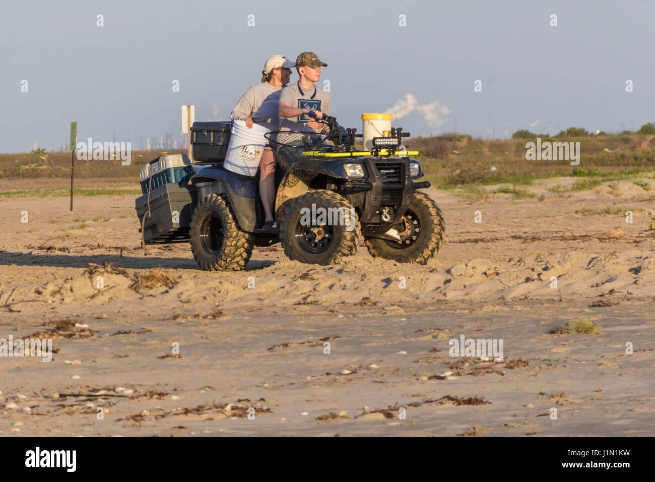 Fishing outing at Galveston East Beach Park in early morning light - Stock Image