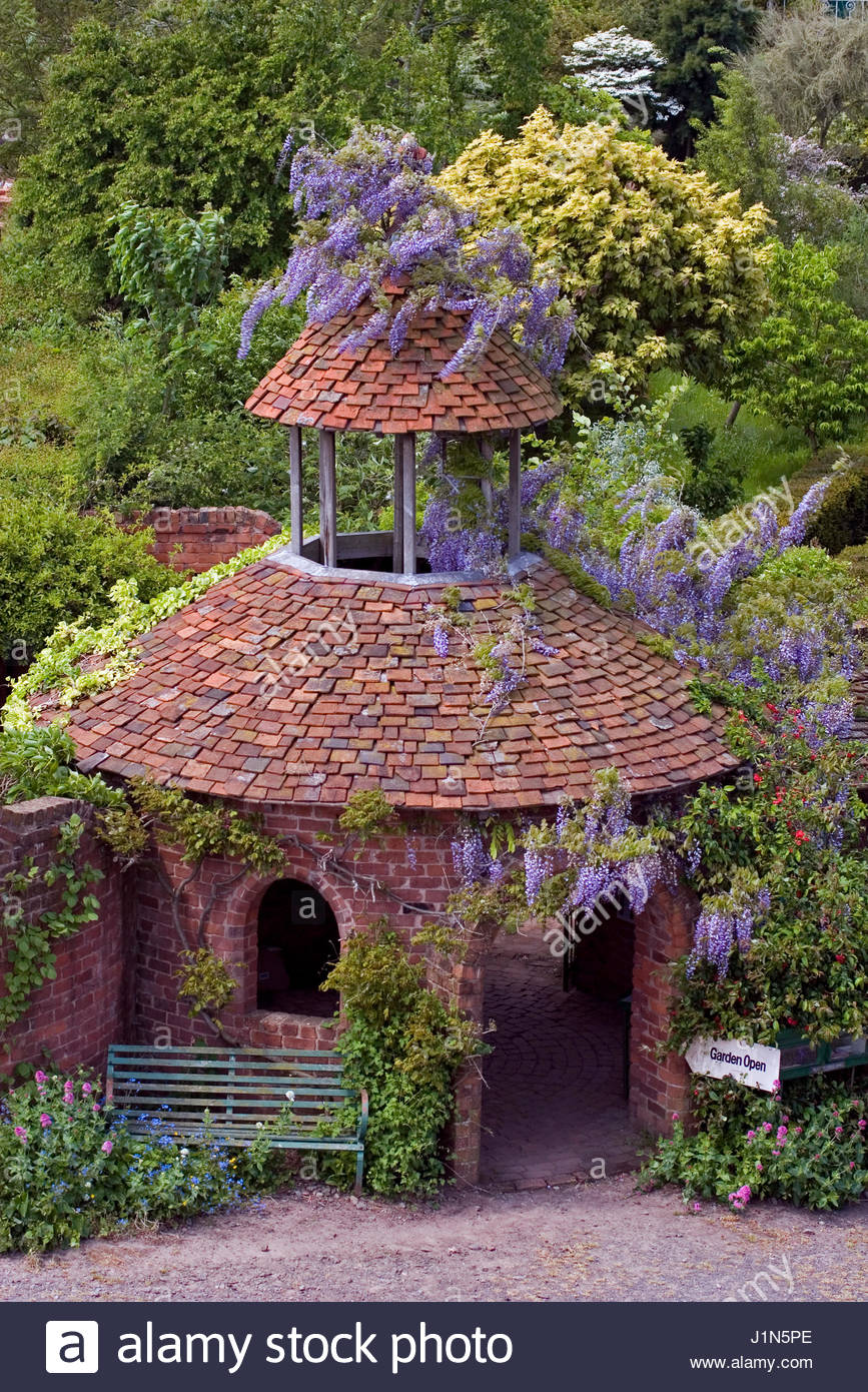 Wisteria clad entrance tower at stone house cottage garden stock wisteria clad entrance tower at stone house cottage garden workwithnaturefo
