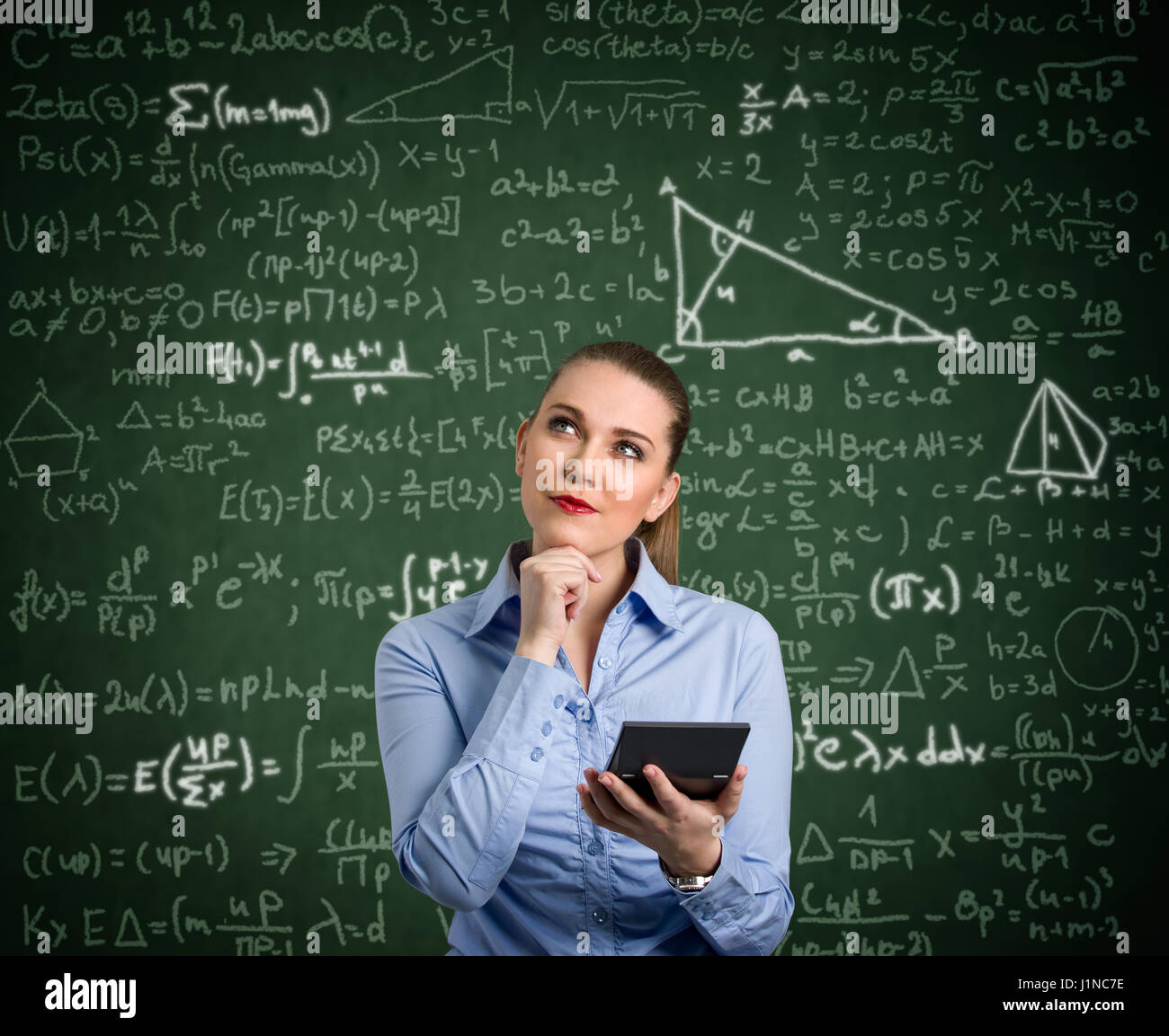 Young woman holding calculator and have problem with mathematics - Stock Image