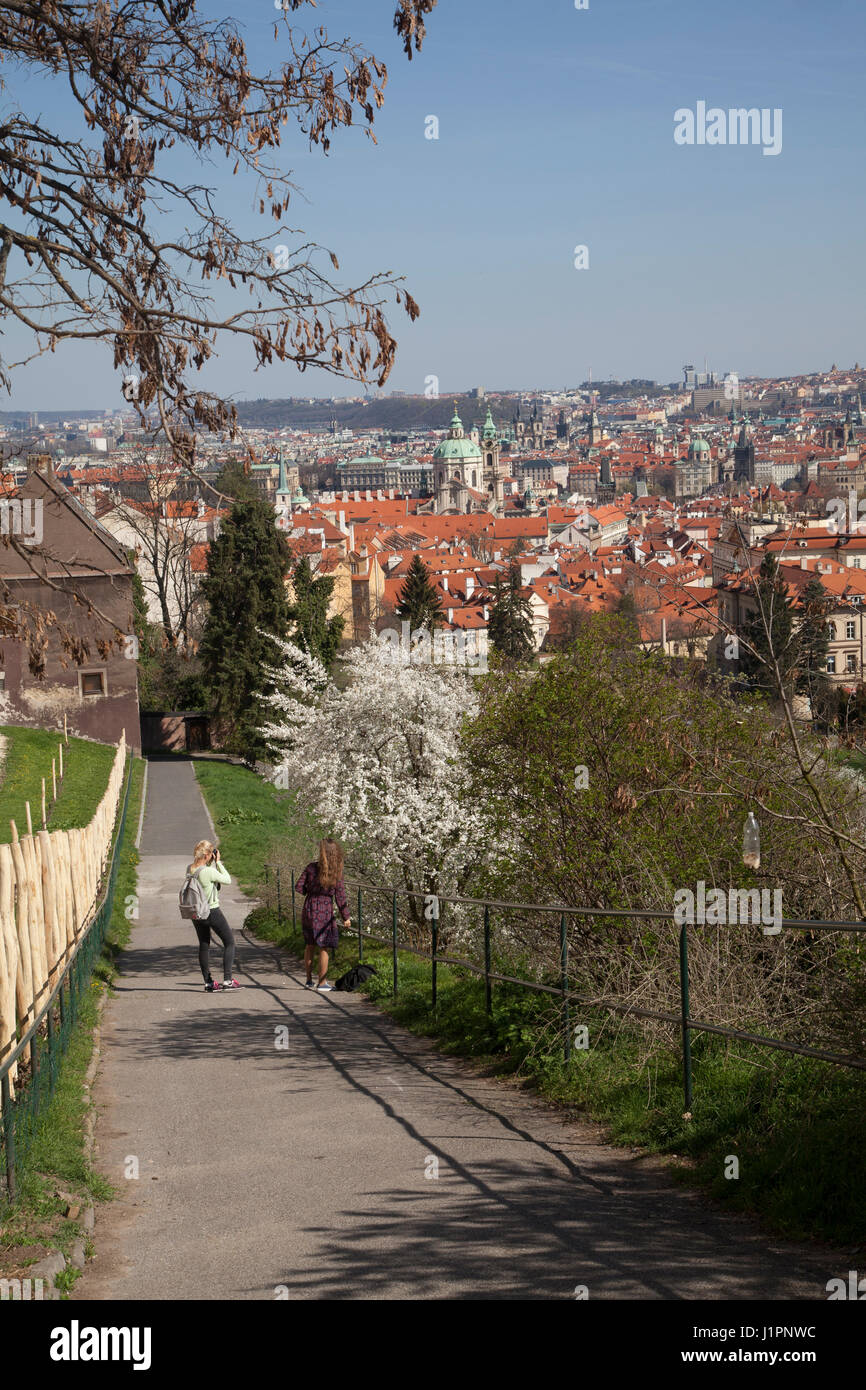 People walking along the path leading from near to the monastery in Prague down to the old town with a view over Stock Photo