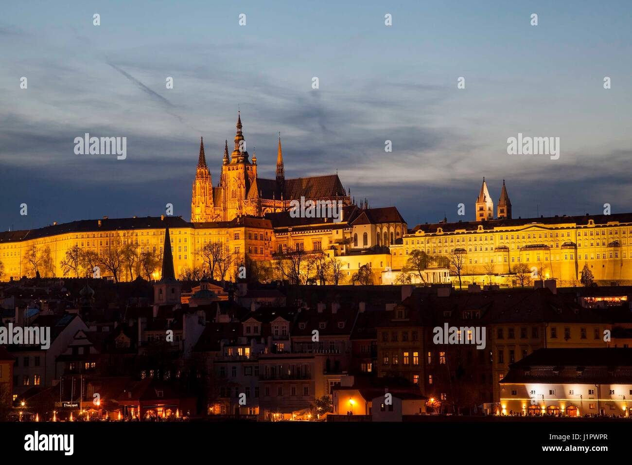 Nighttime view of Prague  over the river Vltava towards the castle - Stock Image