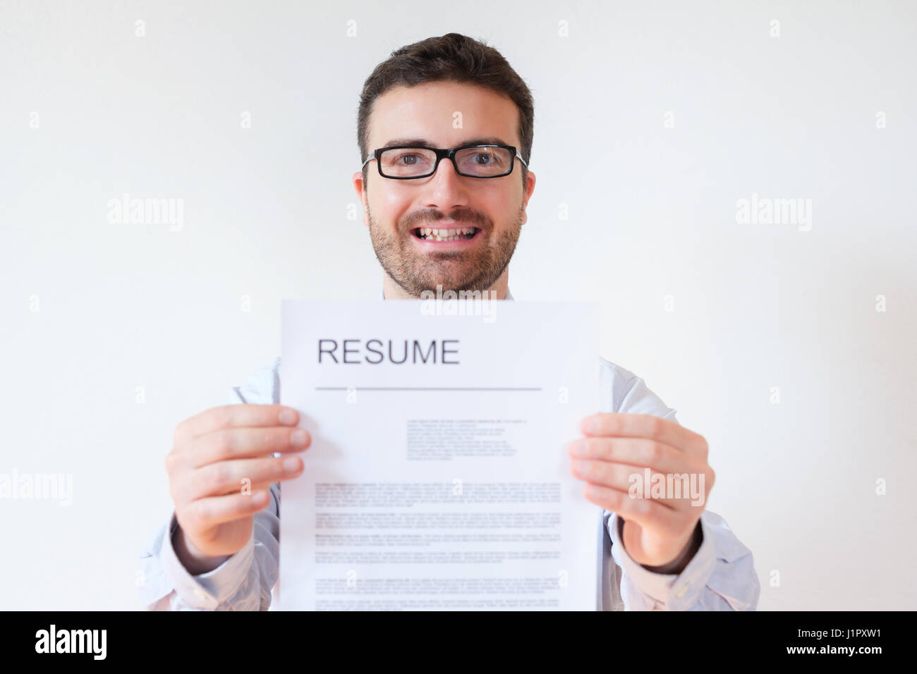 Man with resume and work career ready to find a job - Stock Image