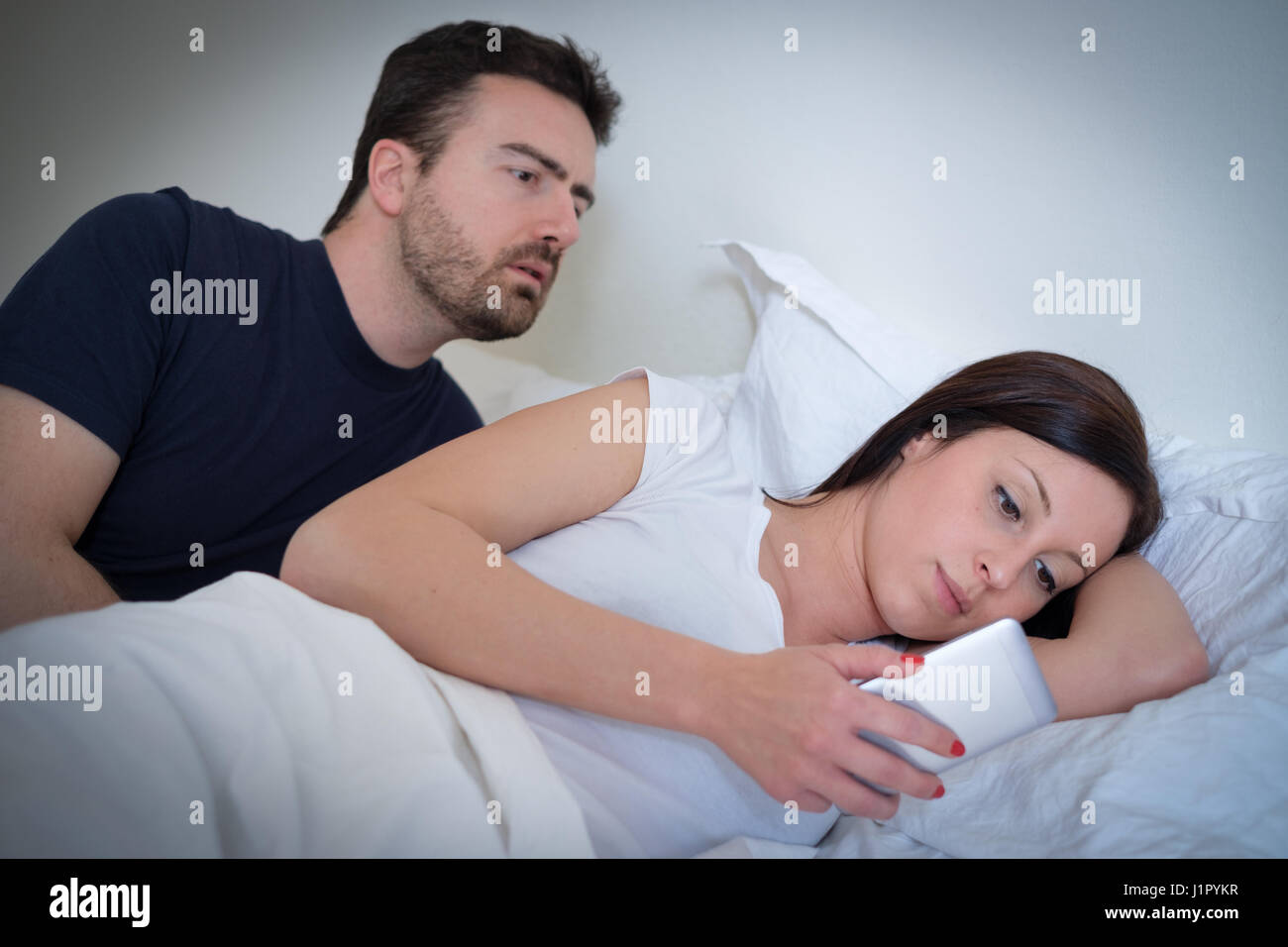 Husband discovering the web treachery of his wife - Stock Image