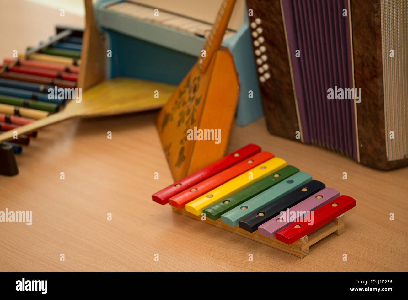 Children's toys musical instruments balalaika, accordion, harpsichord, piano - Stock Image