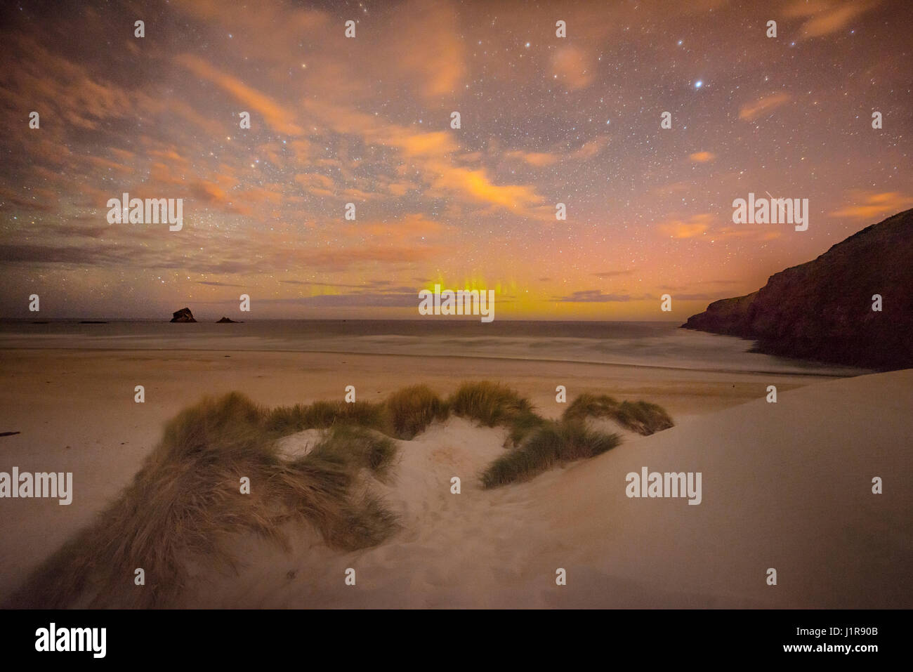 Southern lights, aurora australis over the sea, sand dunes, Sandfly Bay, Dunedin, Otago, Otago Peninsula, Southland, - Stock Image