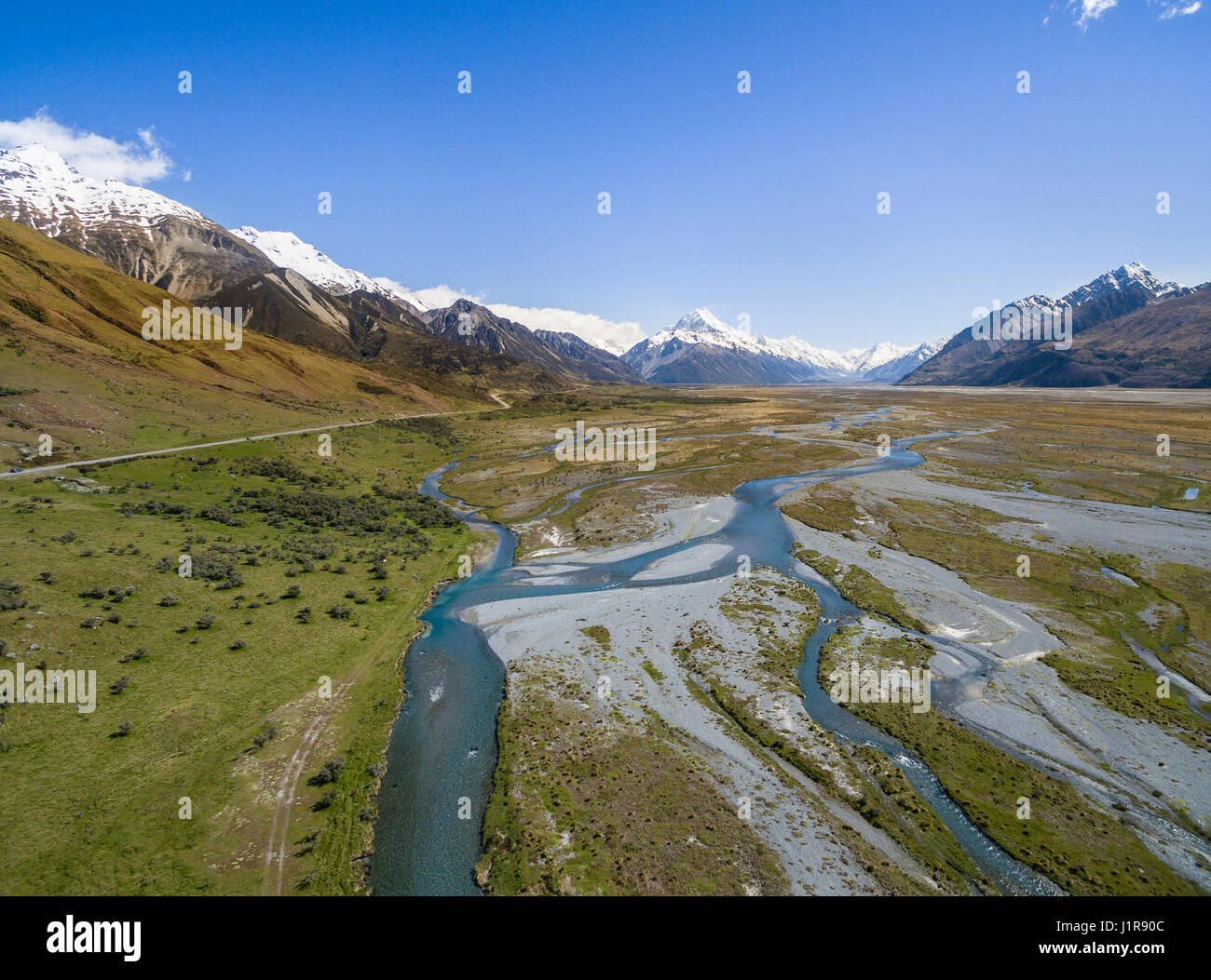 Wide river bed of the Tasman River, at back Mount Cook, Canterbury Region, Southland, New Zealand Stock Photo