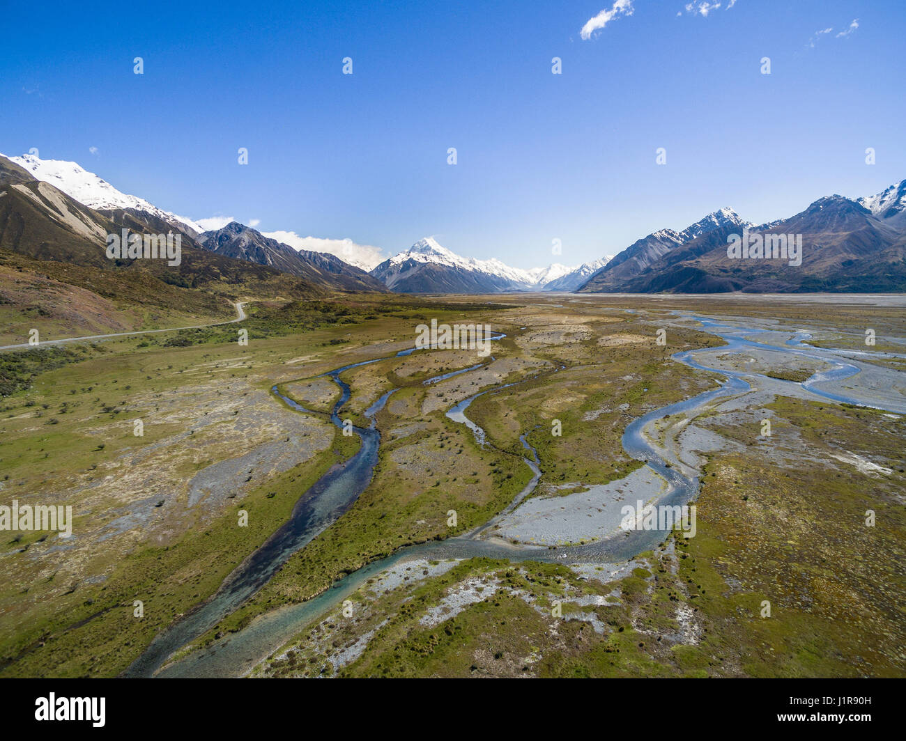 Wide river bed of the Tasman River, at back Mount Cook, Canterbury Region, Southland, New Zealand - Stock Image