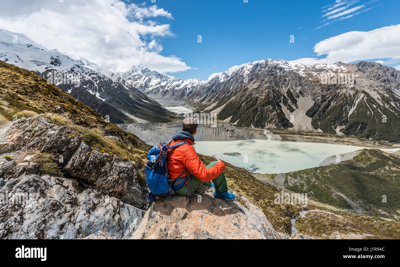 View of Mount Cook and Hooker Valley, hiker looking into valley, Mount Cook National Park, Southern Alps, Canterbury Stock Photo