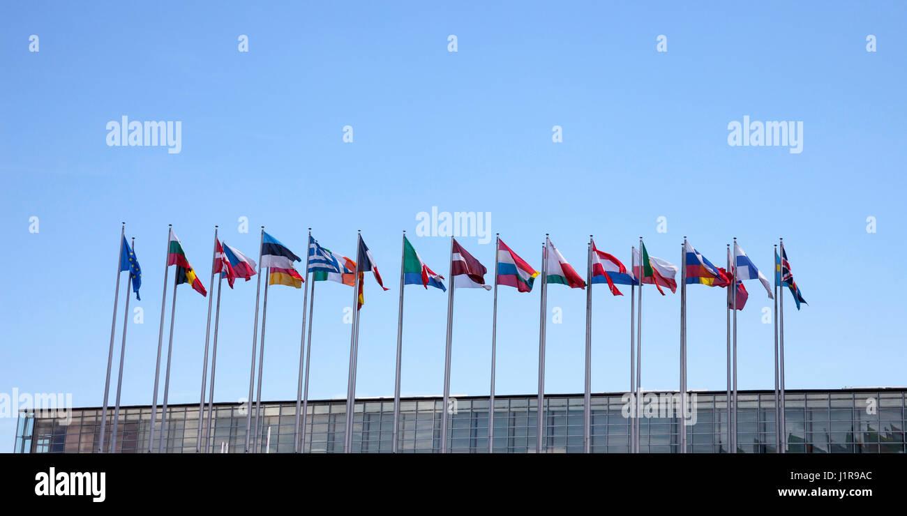 International flags, blue sky, European Parliament, Strasbourg, Alsace, France - Stock Image