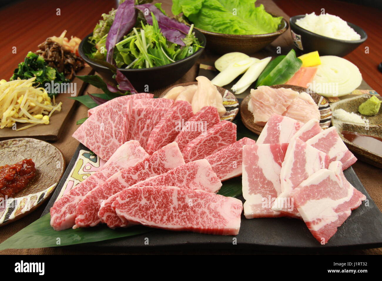 Fresh sliced beef with vegetables on tables in the kitchen Stock Photo