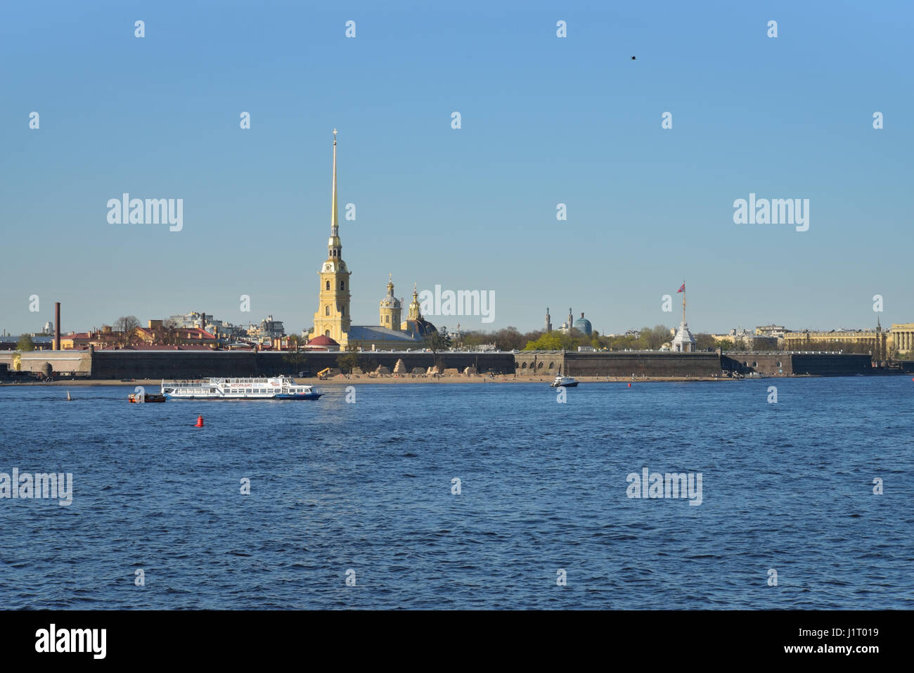 Pleasure boat floats on the Neva river on the background of the fortress clear day in summer in Saint-Petersburg Stock Photo