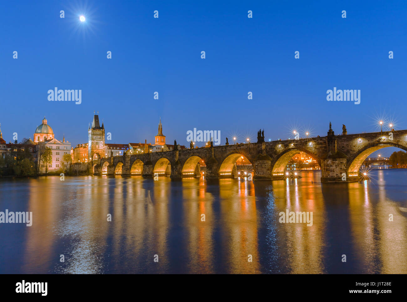 The famous Charles Bridge at sunset in Prague in the Czech Republic - Stock Image