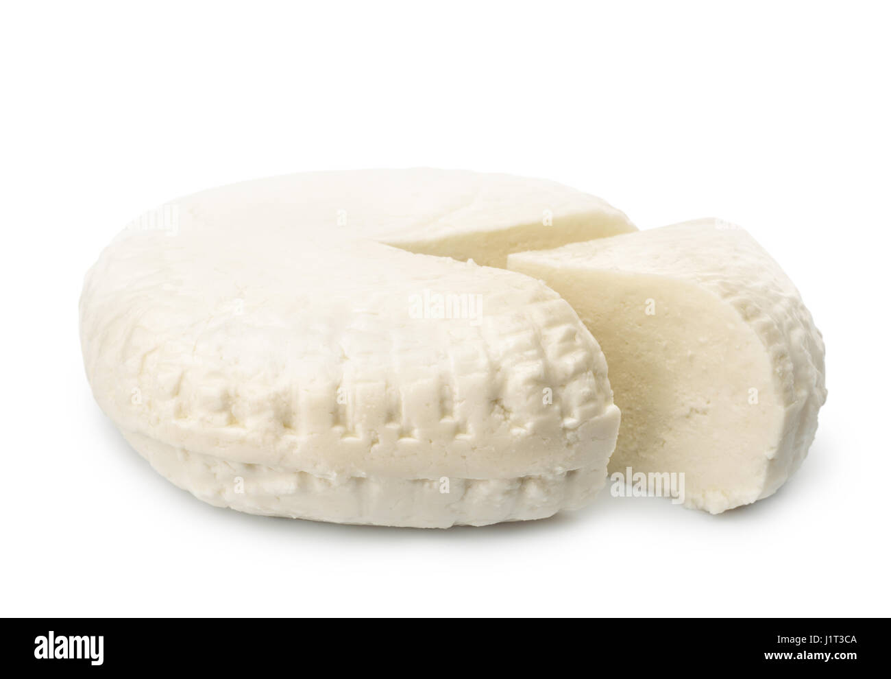 Fresh brined cheese wheel isolated on white Stock Photo