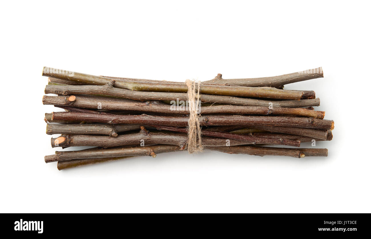 Bunch of wooden twigs isolated on white Stock Photo