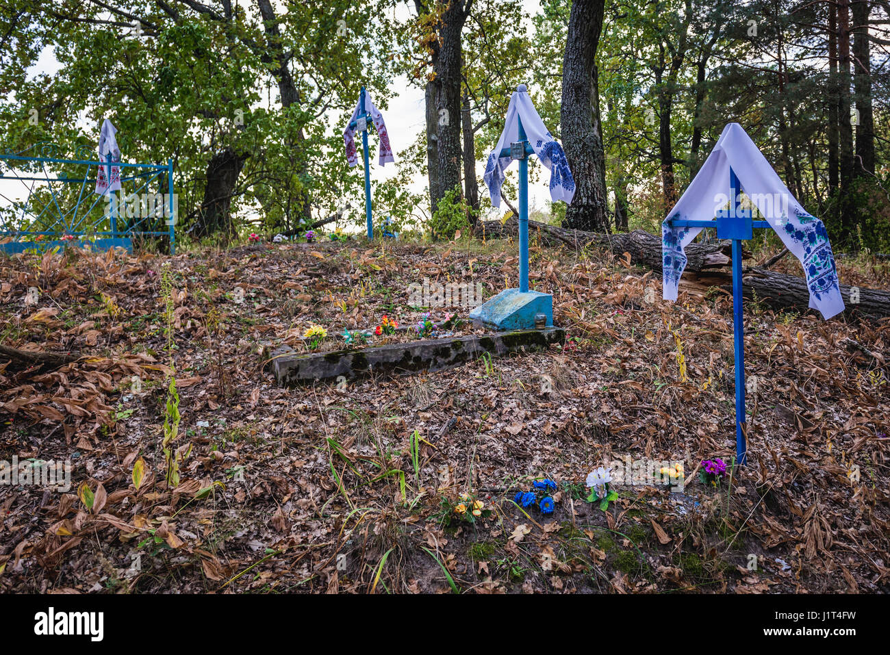 Cemetery in abandoned Zymovyshche village Chernobyl Nuclear Power Plant Zone of Alienation around nuclear reactor - Stock Image