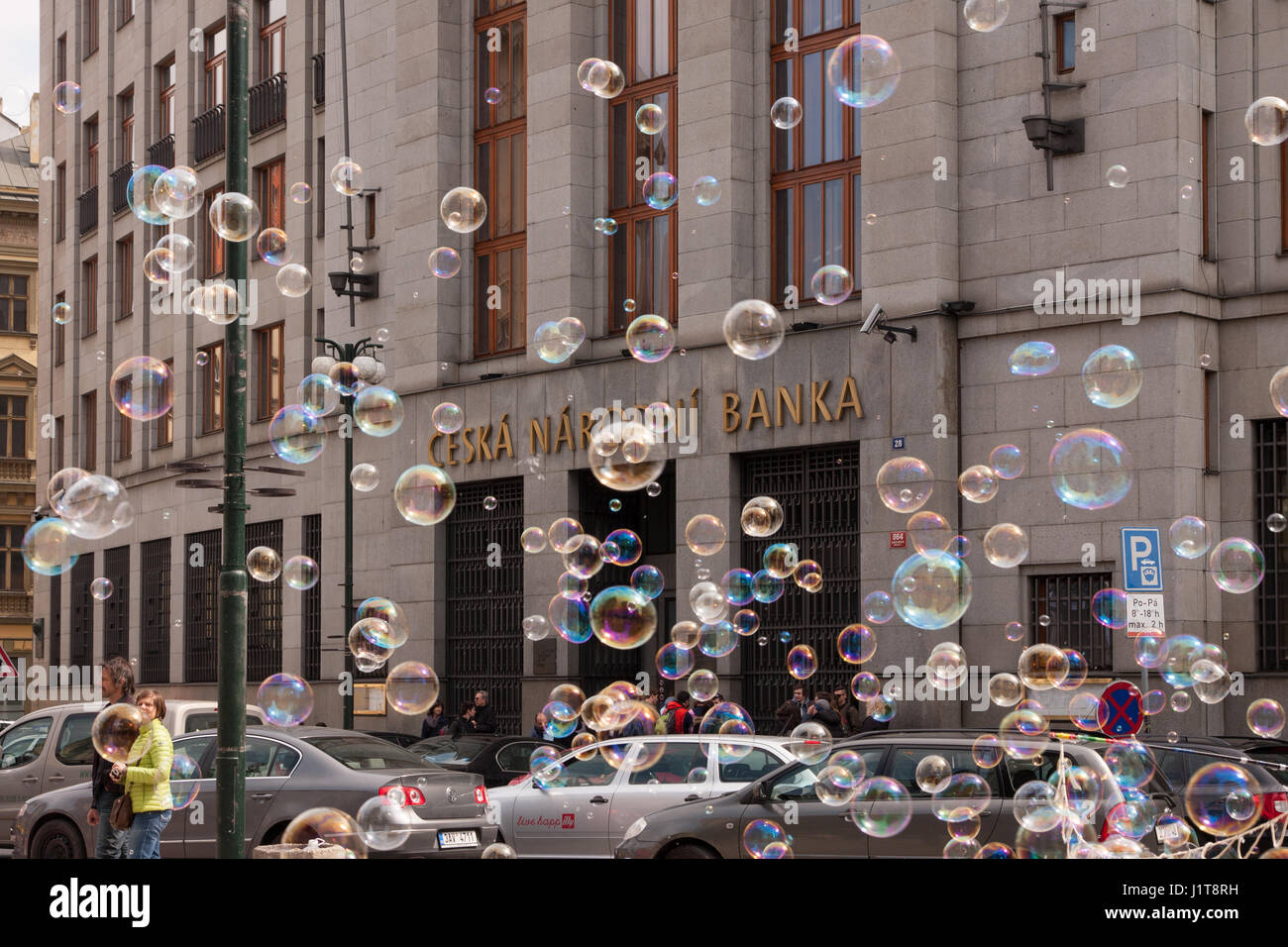 PRAGUE, CZECH REPUBLIC - APRIL 21, 2017: The building of the Czech National Bank, with colorful bubbles floating Stock Photo