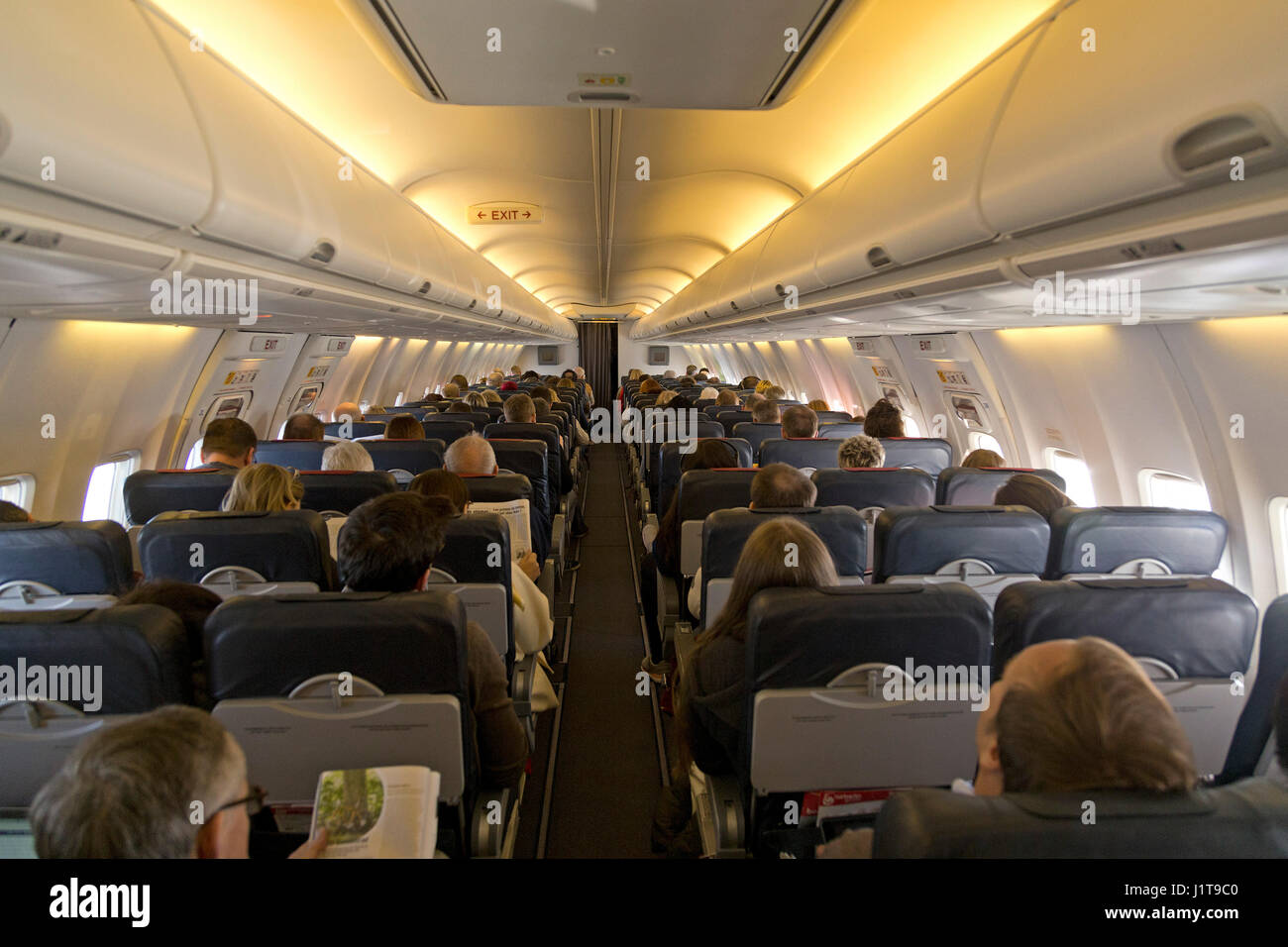 inside a plane from Berlin, Germany, to Palma de Mallorca shortly after takeoff - Stock Image