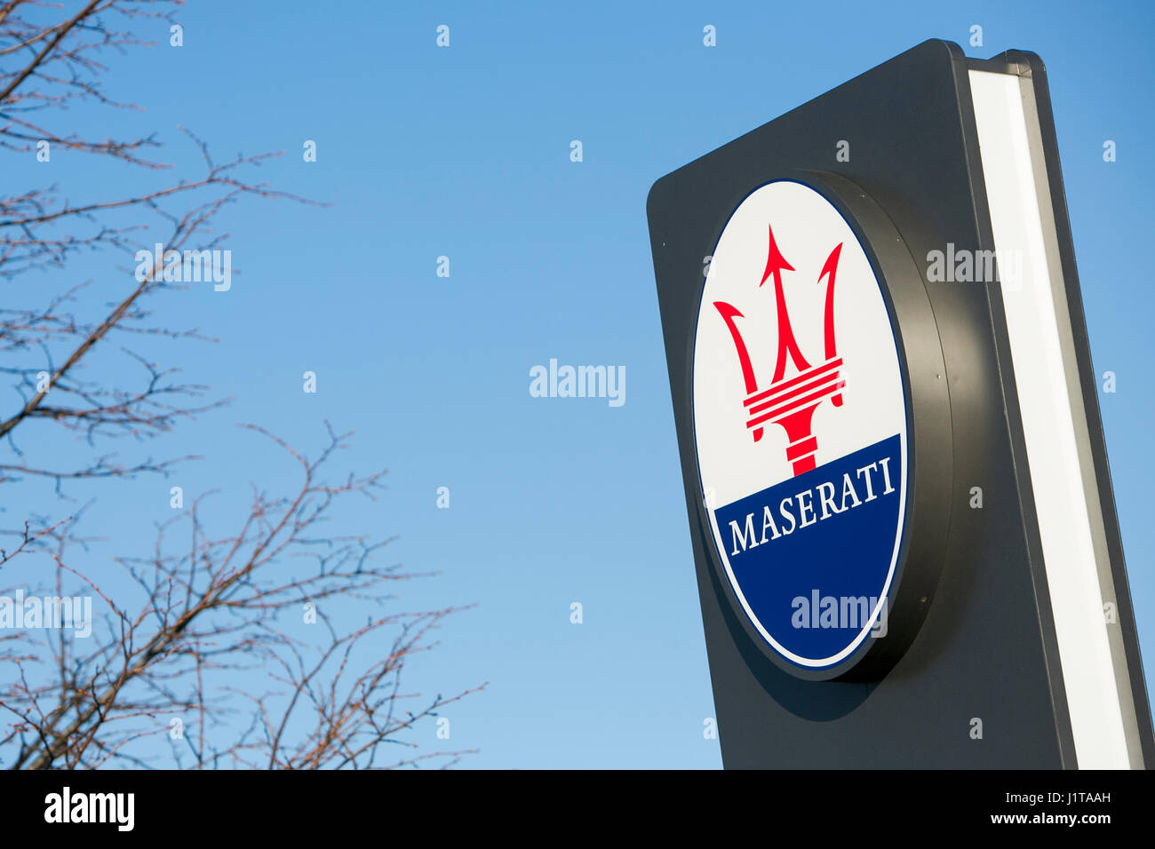 A logo sign outside of a Maserati car dealership in Oakville, ON, Canada on April 14, 2017. - Stock Image