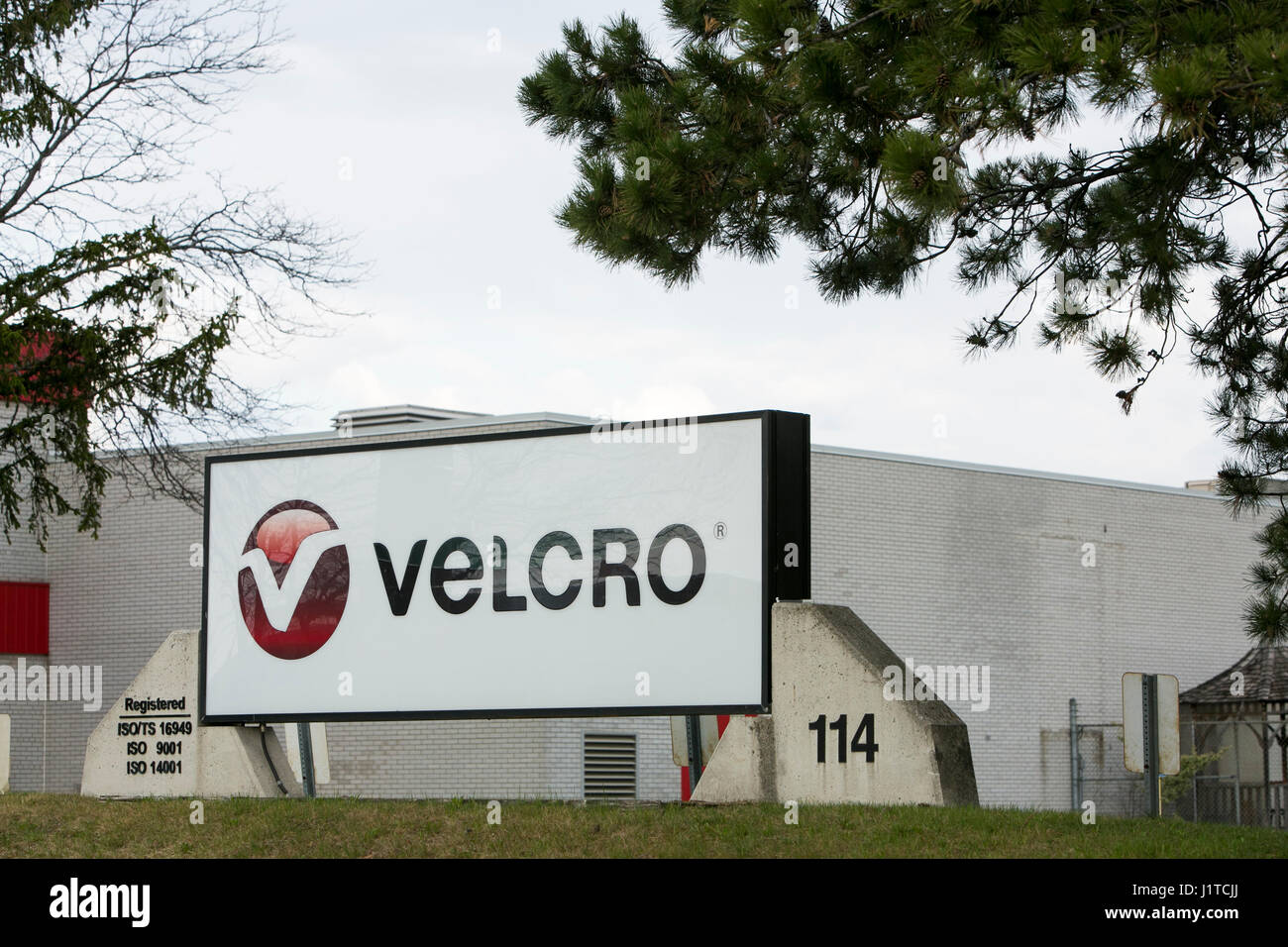 A logo sign outside of a facility occupied by the Velcro Companies in Brampton, Ontario, Canada, on April 16, 2017. - Stock Image