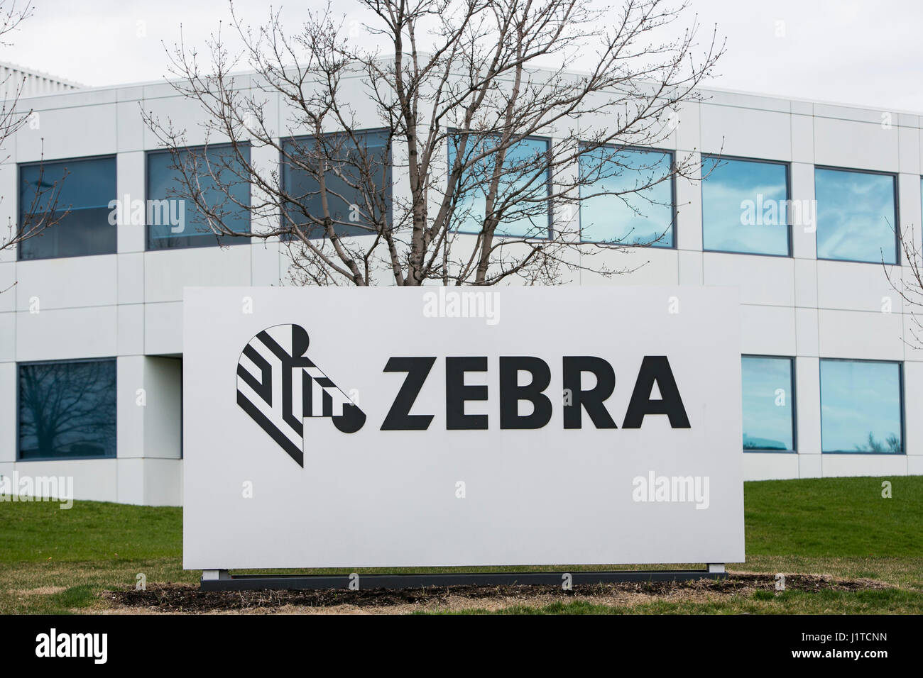 A logo sign outside of a facility occupied by Zebra Technologies in