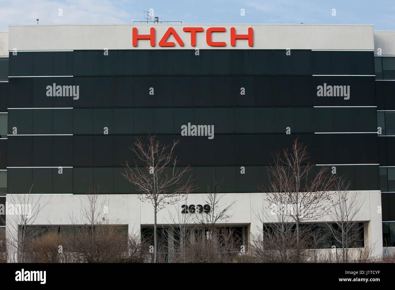 A logo sign outside of the headquarters of Hatch in Mississauga, Ontario, Canada, on April 15, 2017. - Stock Image