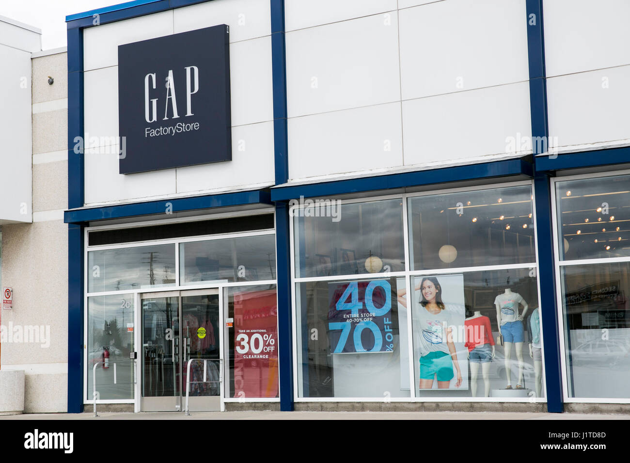 8887570ede209 A logo sign outside of a Gap Factory retail store in Mississauga, Ontario,  Canada, on April 16, 2017.